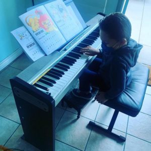 socially distanced piano lesson today